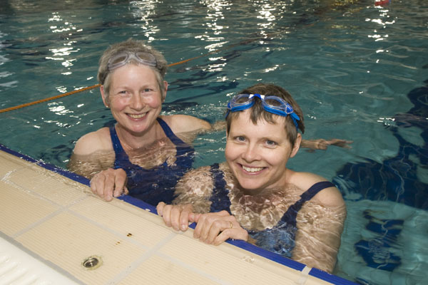Two women swimming in a pool in North Yorkshire.