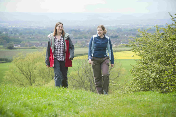 Two women walking in the countryside in North Yorkshire.