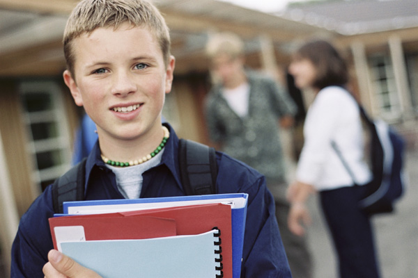 Young male teenager outside school in North Yorkshire.