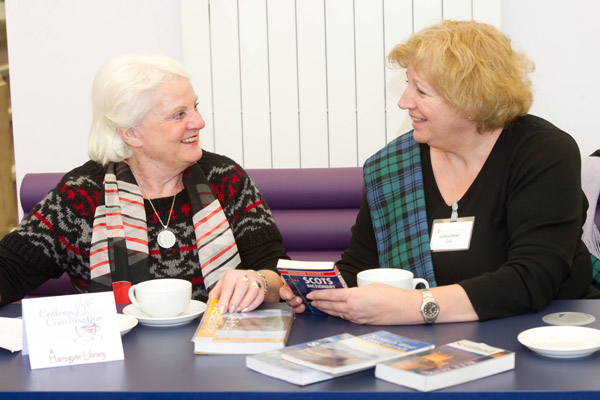 Two women talking at a reading group at a library in North Yorkshire.