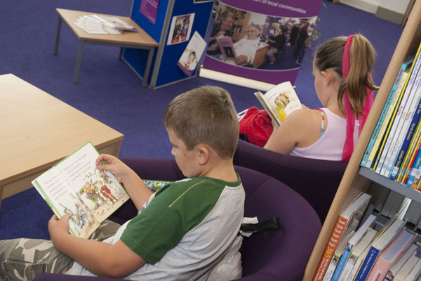 Young people reading books in a library in North Yorkshire.