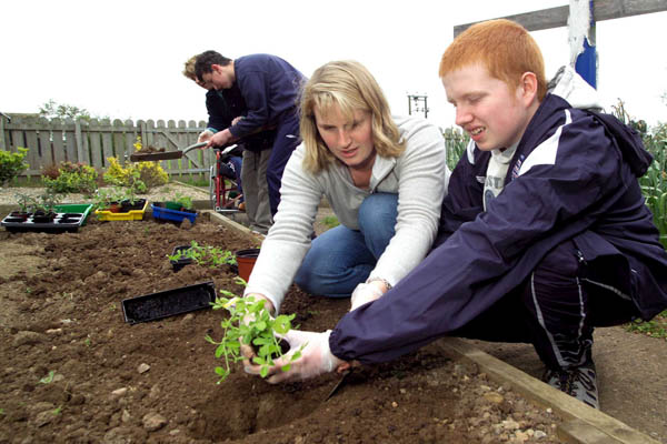 Student and teacher gardening in a school in North Yorkshire.