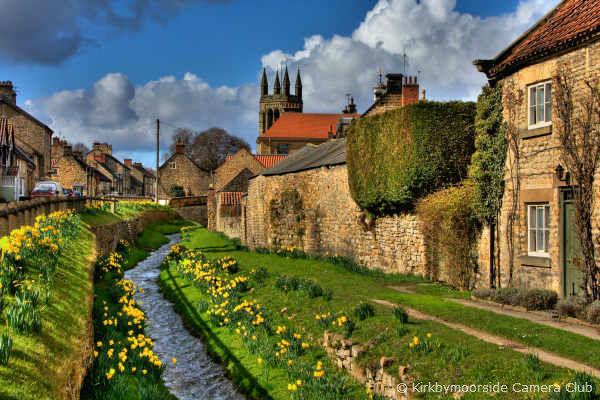 A photo of Helmsley in Ryedale with bright yellow daffodils