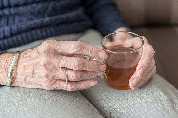 Elderly person holding a cup of tea in North Yorkshire