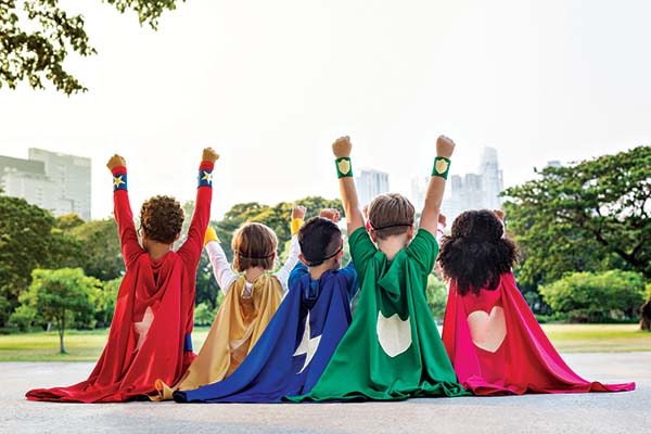 Row of children dressed as superheroes.