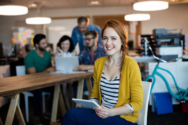 Young woman working within a technology and change office.