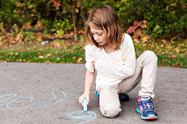 Girl playing with chalk