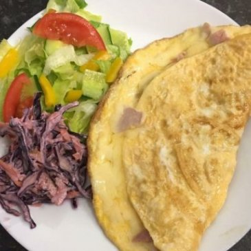 An omelette with accompanying salad at Mrs Smith's cafe