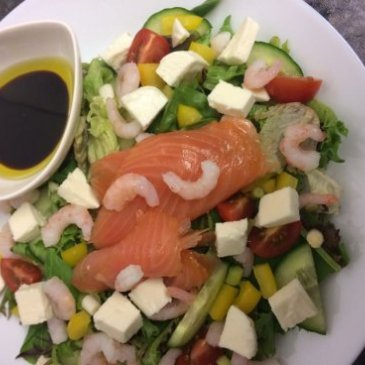 Salmon on a plate of salad at Mrs Smith's cafe