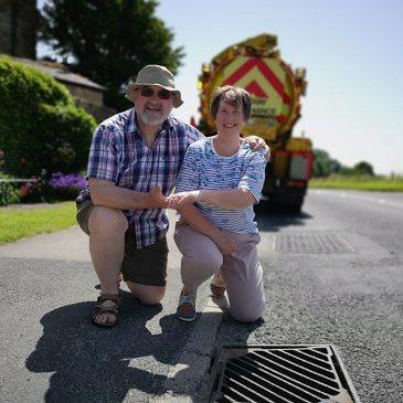 Linda and Rob Baines at the drain which the ring disappeared into