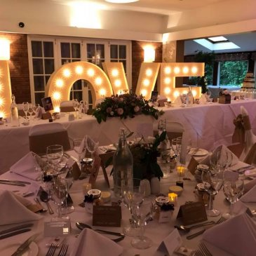 Bride and groom table with dinner table set up at Dower House Hotel