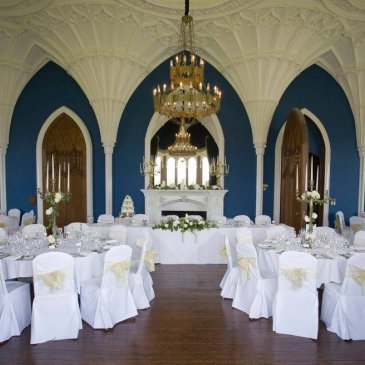 Grand hall with chandeliers, chairs and  tables