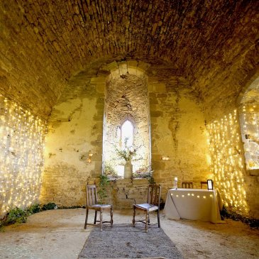 Sheriff Hutton castle with seating and fairy lights