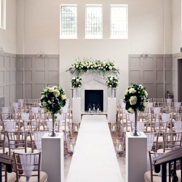 Chairs and aisle with flowers