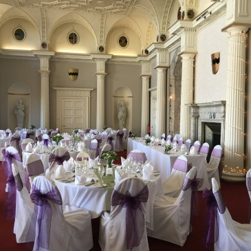 Seats and tables set out for wedding dinner