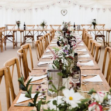 Tables and chairs laid out prepared for wedding meal