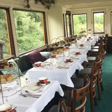 Train carriage with chairs and tables for wedding meal