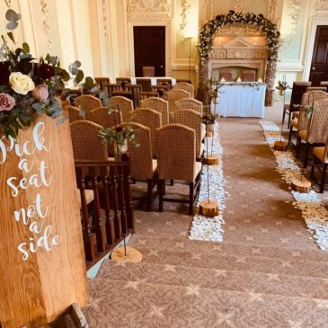 Chairs laid out on each side of aisle facing wedding ceremony