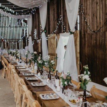Long table with chairs and floral centre pieces