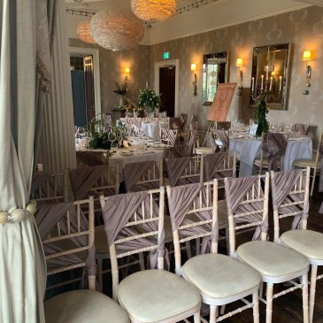 Chair and tables set out for wedding dinner