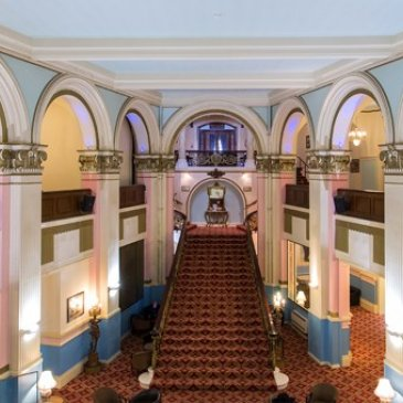 Overview of spectacular high ceilings and archways in Grand Hotel