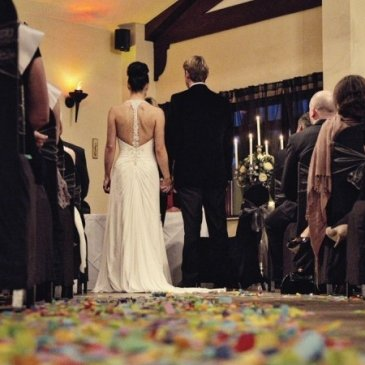 Aisle with bride and groom saying vows