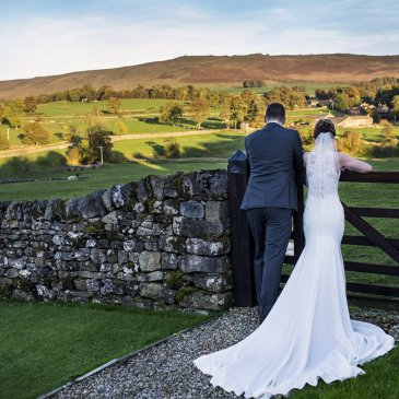 Bride and groom looking over beautiful landscape