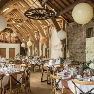 Grand barn with tables and chairs for wedding dinner