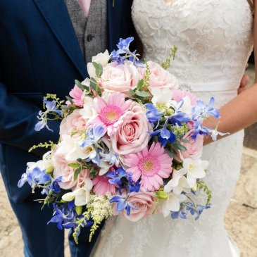 Bride with beautiful and big bouquet of flowers