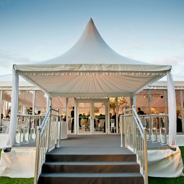 Grand marquee with seating for wedding dinner