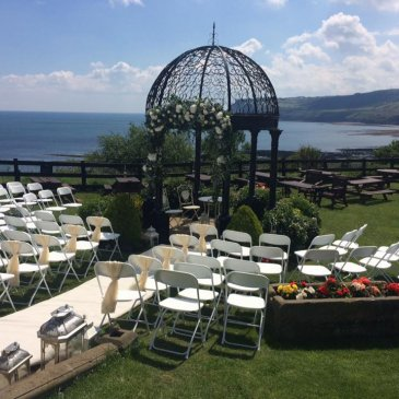 Outside shot of chairs laid out for wedding ceremony