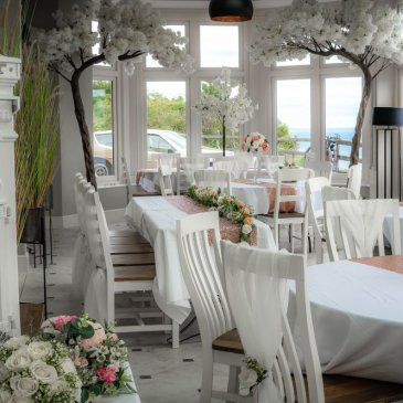 Chairs and tables set out for wedding dinner