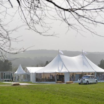 Marquee set out on large field ready for wedding