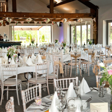 Tables and chairs set for wedding dinner