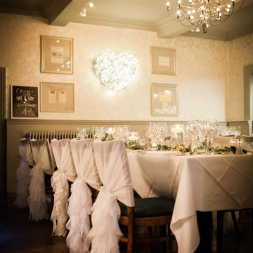 Long table with seats each side for intimate wedding meal