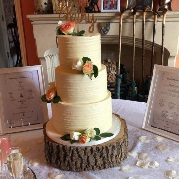 Large wedding cake sat in middle of table