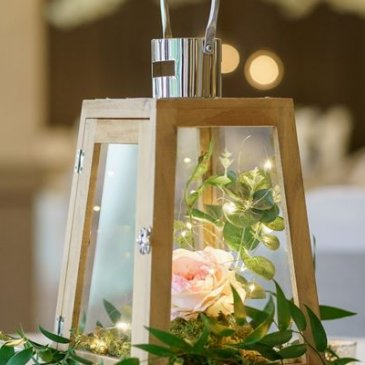 Little decorative lantern in the middle of table
