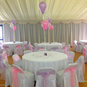Tables and chairs with balloon decorations