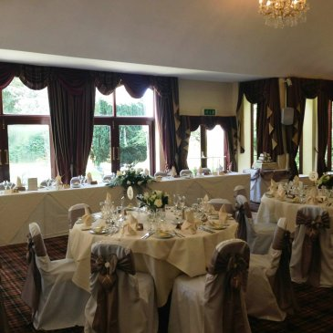 Tables and chairs set out for wedding meal