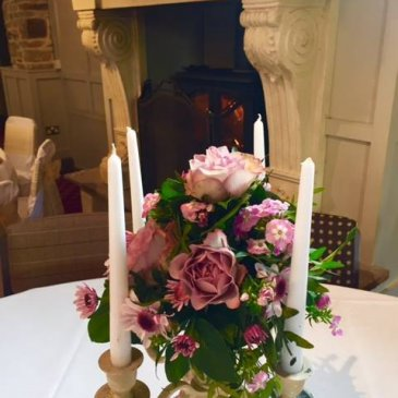 Beautiful floral table centre piece with candles