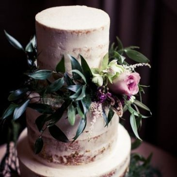 Large wedding cake with floral decoration ready for celebration