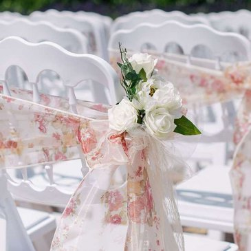 Chairs wrapped in floral ribbons