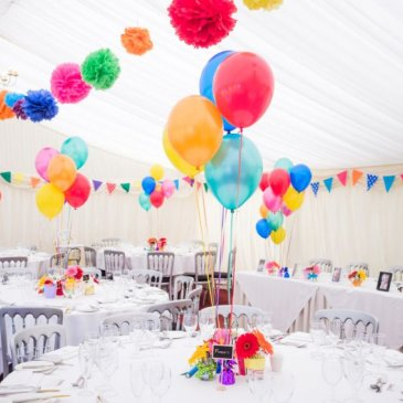 Seats and tables set out with balloon decorations