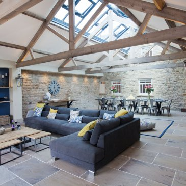 Large open interior of Greenbank Barns with furniture