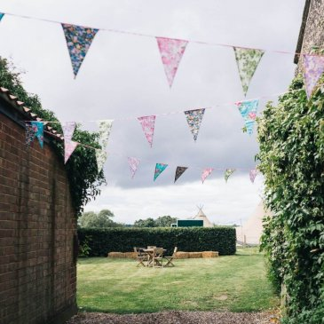 Bunting set up on open space at wedding venue