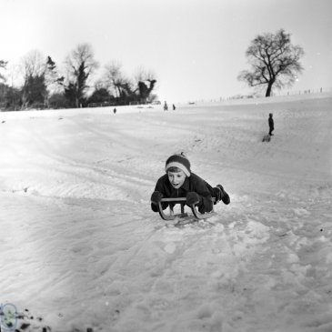 Sledging down a hill in Ripley in 1963