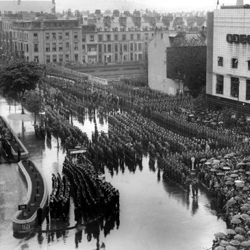 An open-air service to commemorate Victory in Europe Day in 1945 in Scarborough. Troops are lined up between the railway station, the Odeon Cinema and West Square.