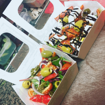 Photograph of salad boxes served at the Central Coffee House