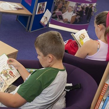 Children reading at a library in North Yorkshire.