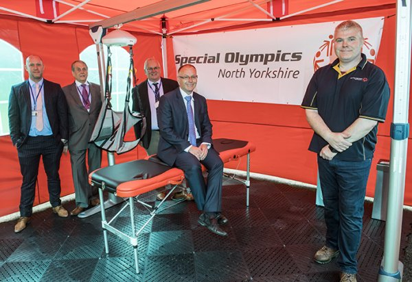 Taking a look at the mobile changing place are (from left) county councillors Callum Walsh, David Chance, Executive Member for Stronger Communities, Bob Baker and Gareth Dadd, Member for Thirsk and Deputy Leader, with Andrew Newton, chairman of Special Olympics North Yorkshire